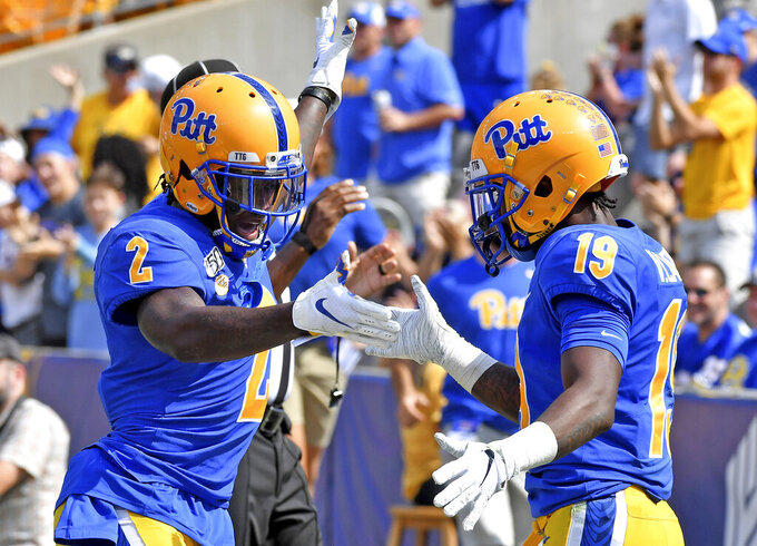 Pitt wide receiver Maurice Ffrench congratulates V'Lique Carter after he pulled in a pass for a touchdown against Delaware in the second quarter of an NCAA college football game Saturday, Sept. 28 2019, at Heinz Field in Pittsburgh. (Matt Freed/Pittsburgh Post-Gazette via AP)