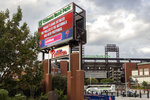 A sign outside the stadium advises that the baseball game between the Philadelphia Phillies and the Washington Nationals has been postponed, Wednesday, July 28, 2021, in Philadelphia. The postponement was due to COVID-19 issues among the Nationals. (AP Photo/Laurence Kesterson)