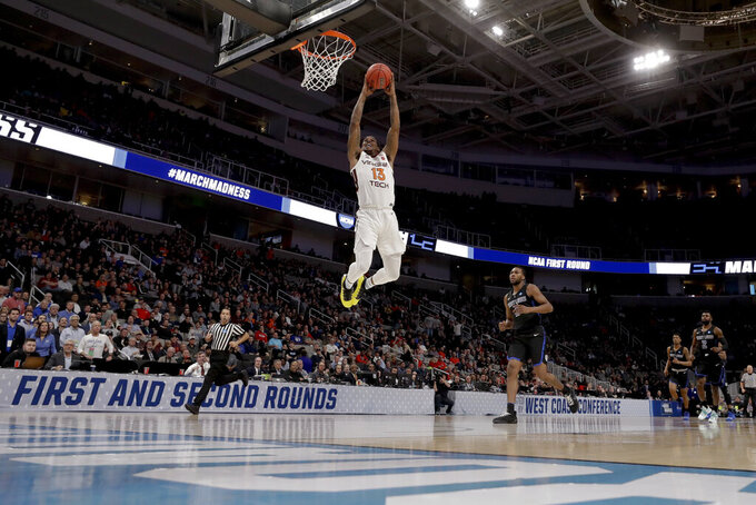 Virginia Tech guard Ahmed Hill dunks against Saint Louis during the first half of a first-round game in the NCAA men's college basketball tournament Friday, March 22, 2019, in San Jose, Calif. (AP Photo/Jeff Chiu)