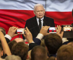 Leader of Poland's ruling party Jaroslaw Kaczynski speaks in reaction to exit poll results right after voting closed in the nation's parliamentary election that is seen crucial for the nation's course in the next four years, in Warsaw, Poland, on Sunday, Oct. 13, 2019. (AP Photo)