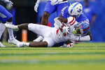 Kentucky linebacker Jamin Davis, top, tackles Mississippi wide receiver Demarcus Gregory (3) during the first half of an NCAA college football game, Saturday, Oct. 3, 2020, in Lexington, Ky. (AP Photo/Bryan Woolston)
