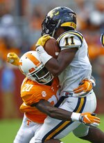 FILE - In this Sept. 8, 2018, file photo, East Tennessee State University's Quay Holmes (11) is tackled by Tennessee defensive back Bryce Thompson (20) in the first half of an NCAA college football game, in Knoxville, Tenn. Tennessee safety Bryce Thompson has 23 tackles, two interceptions and a forced fumble in eight games.(AP Photo/Wade Payne, File)