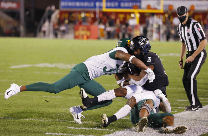 Baylor cornerback Mark Milton, left, and linebacker Ashton Logan, bottom, force Iowa State running back Kene Nwangwu out of bounds during the second half of an NCAA college football game Saturday, Nov. 7, 2020, in Ames, Iowa. Iowa State won 38-31. (AP Photo/Matthew Putney)