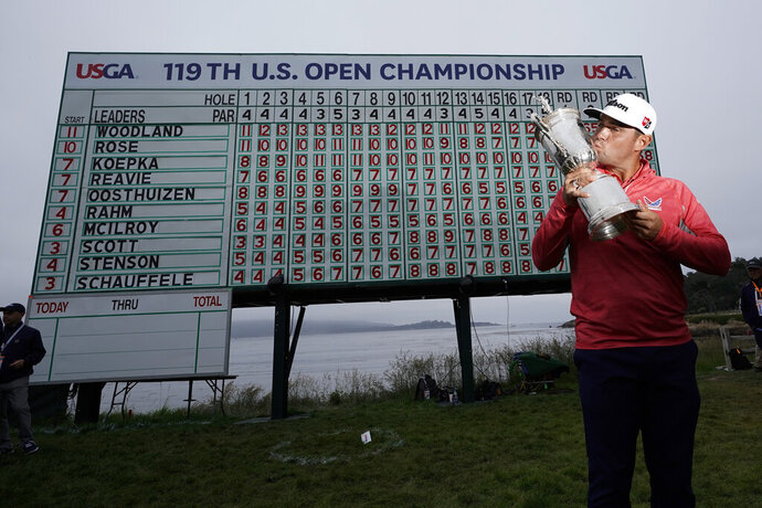 FILE - In this June 16, 2019, file photo, Gary Woodland poses with the trophy after winning the U.S. Open Championship golf tournament in Pebble Beach, Calif. Due to the coronavirus pandemic, the golf to watch on Father's Day this year will not be the U.S. Open as is usually the case. (AP Photo/David J. Phillip, File)