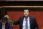 Italian Interior Minister and Vice Premier Matteo Salvini looks up at the Italian Senate, in Rome, Wednesday, March 20, 2019. The Senate is scheduled to vote on whether to lift Parliamentary immunity on Salvini in order for him to be prosecuted by a special tribunal for government ministers for suspected abduction, illegal arrest and abuse of office when he refused to let rescued migrants who were not minors or ill off the Italian Coast Guard Diciotti ship last August. At left is Italian Minister of Public Administration Giulia Bongiorno. (AP Photo/Alessandra Tarantino)