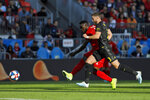 Toronto FC forward Jozy Altidore (17) tries to get a shot on goal past Columbus Crew defender Josh Williams (3) during an MLS soccer match in Toronto, Sunday, Oct. 6, 2019. (Cole Burston/The Canadian Press via AP)