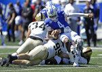 Georgia State quarterback Cornelious Brown IV (4) is tackled by Army defensive lineman Chris Frey (99) during the first quarter of an NCAA football game Saturday, Sept. 4, 2021, in Atlanta. (AP Photo/Ben Margot)