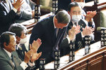 Yoshihide Suga bows after being elected as Japan's new prime minister at the parliament's lower house in Tokyo, Wednesday, Sept. 16, 2020. Suga was formally elected Wednesday as new prime minister in a parliamentary vote, replacing Shinzo Abe. (AP Photo/Koji Sasahara)