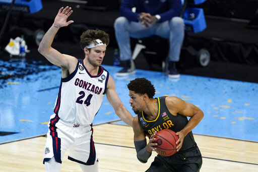 Baylor guard MaCio Teague drives past Gonzaga forward Corey Kispert (24) during the first half of the championship game in the men's Final Four NCAA college basketball tournament, Monday, April 5, 2021, at Lucas Oil Stadium in Indianapolis. (AP Photo/Darron Cummings)