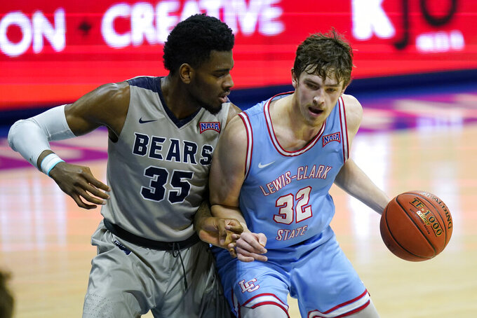 Shawnee State forward EJ Onu (35) defends against Lewis-Clark State forward Trystan Bradley (32) during the first half of final in the NAIA men's college basketball tournament in Kansas City, Mo., Tuesday, March 23, 2021. (AP Photo/Orlin Wagner)