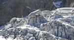 This image taken from a video shows an aerial view of part of the Planpincieux Glacier, which lies under a massif of Mont Blanc, located in the Alps, Friday, Aug. 7, 2020. Experts are closely monitoring a glacier they fear could break apart and crash into an Italian Alpine valley. On Thursday, 75 residents and tourists in the Ferret valley were evacuated from their homes and two lodgings in the shadow of the glacier. The glacier's size has been likened to that of a soccer field under a 80-meter (265 foot) high mass of ice. Sharp shifts in temperature are blamed for the risk. (AP Photo/Local Team)