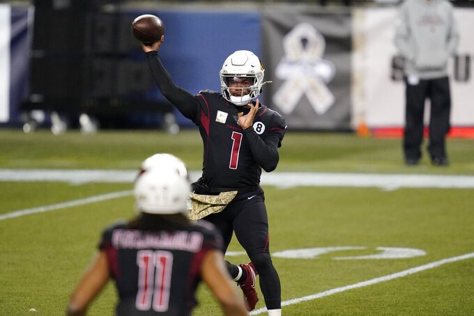 Arizona Cardinals quarterback Kyler Murray (1) passes to wide receiver Larry Fitzgerald (11) during the first half of an NFL football game against the Seattle Seahawks, Thursday, Nov. 19, 2020, in Seattle. (AP Photo/Elaine Thompson)