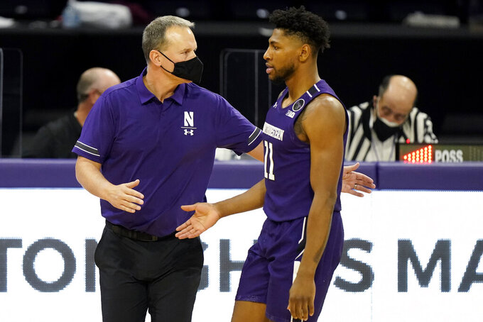 Northwestern head coach Chris Collins, left, celebrates with guard Anthony Gaines during the second half of an NCAA college basketball game against Chicago State in Evanston, Ill., Saturday, Dec. 5, 2020. Northwestern won 111-66. (AP Photo/Nam Y. Huh)