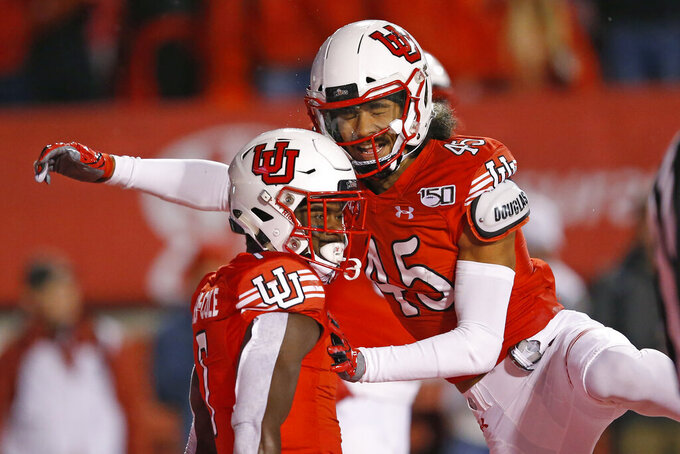 Utah's Devonta'e Henry-Cole (7) celebrates with teammate Samson Nacua (45) after scoring against Washington State in the first half of an NCAA college football game Saturday, Sept. 28, 2019, in Salt Lake City. (AP Photo/Rick Bowmer)