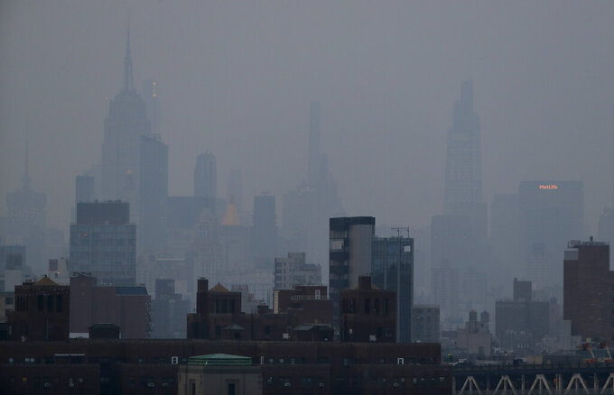 A thick haze hangs over Manhattan, Tuesday, July 20, 2021, in New York. Wildfires in the American West, including one burning in Oregon that's currently the largest in the U.S., are creating hazy skies as far away as New York as the massive infernos spew smoke and ash into the air in columns up to six miles high. (AP Photo/Julie Jacobson)