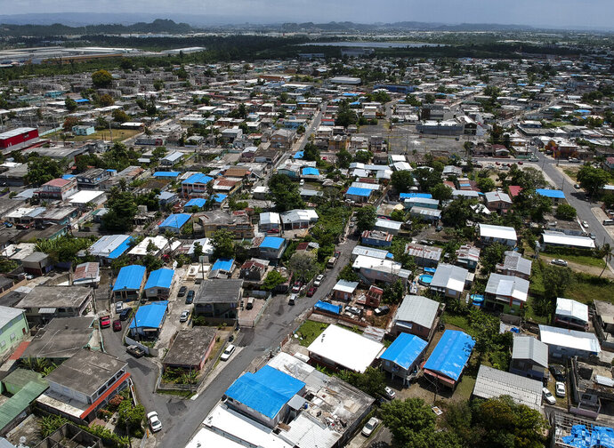 This June 18, 2018, file photo shows an aerial view of the Amelia neighborhood in the municipality of Catano, east of San Juan, Puerto Rico. A long-delayed disaster aid bill that's a top political priority for some of President Donald Trump's GOP allies is facing a potentially tricky path as it heads to the Senate floor this week. Although the measure has wide backing from both parties, the White House isn't pleased with the bill and is particularly opposed to efforts by Democrats to make hurricane relief to Puerto Rico more generous. (AP Photo/Dennis M. Rivera, File)