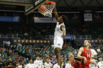 Washington guard Nahziah Carter (11) dunks over Ball State during the second half of an NCAA college basketball game, Sunday, Dec. 22, 2019, in Honolulu. (AP Photo/Marco Garcia)