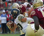 Wake Forest's Sam Hartman is flushed from the pocket and scrambles for yardage in the second quarter of an NCAA college football game against Florida State, Saturday, Oct. 20, 2018 in Tallahassee, Fla. Florida State won 38-17. (AP Photo/Steve Cannon)