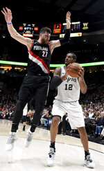 San Antonio Spurs center LaMarcus Aldridge, right, gets Portland Trail Blazers center Jusuf Nurkic, left, up in the air during the first half of an NBA basketball game in Portland, Ore., Thursday, Feb. 7, 2019. (AP Photo/Steve Dykes)