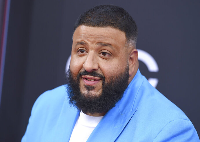 FILE - This May 20, 2018 file photo shows DJ Khaled at the Billboard Music Awards in Las Vegas. In the run-up to the Kids' Choice Awards, host DJ Khaled is feeling plenty of support _ from his son. The producer-DJ said his 2-year-old son, Asahd, gets excited just watching his dad in the ads promoting the show on Nickelodeon. (Photo by Jordan Strauss/Invision/AP, File)
