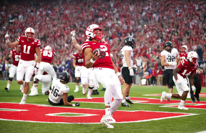 Nebraska quarterback Adrian Martinez (2) runs in for a touchdown early in the first quarter against Northwestern in an NCAA college football game, Saturday, Oct. 2, 2021, at Memorial Stadium in Lincoln, Neb. (AP Photo/Rebecca S. Gratz)