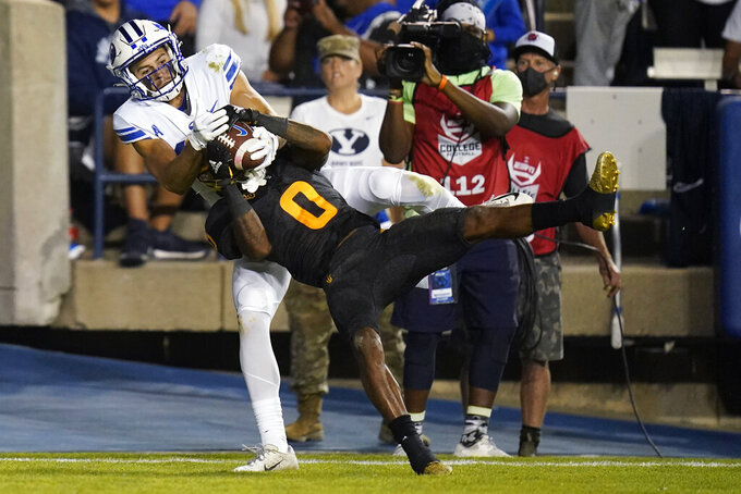 Arizona State defensive back Jack Jones (0) makes an interception in front of BYU wide receiver Gunner Romney during the first half of an NCAA college football game Saturday, Sept. 18, 2021, in Provo, Utah. (AP Photo/Rick Bowmer)