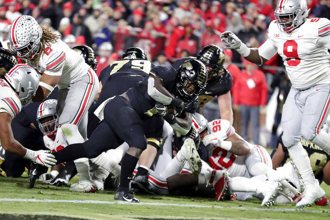 Purdue running back D.J. Knox (1) dives into the end zone for a touchdown against Ohio State during the second half of an NCAA college football game in West Lafayette, Ind., Saturday, Oct. 20, 2018. (AP Photo/Michael Conroy)