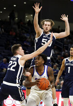 Butler forward Sean McDermott (22) and center Joey Brunk, top, guard DePaul forward Femi Olujobi during the second half of an NCAA college basketball game Wednesday, Jan. 16, 2019, in Chicago. Butler won 87-69. (AP Photo/Nam Y. Huh)