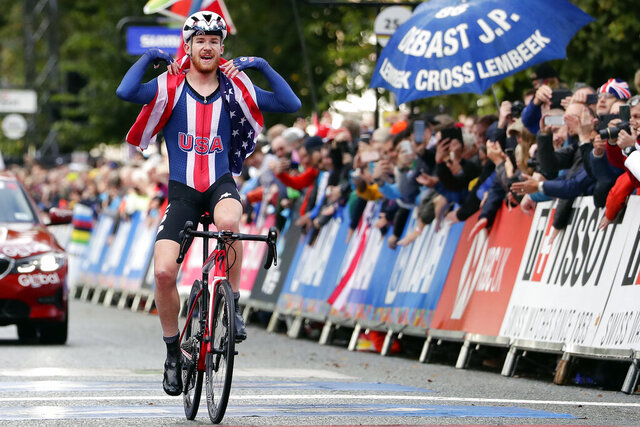 FILE - In this Thursday, Sept. 26, 2019 file photo, United States' Quinn Simmons celebrates winning the men's junior event, at the road cycling World Championships in Harrogate, England. American cyclist Quinn Simmons was suspended by the Trek-Segafredo team on Thursday Oct. 1, 2020, for social media comments supporting President Donald Trump. The 2019 junior road race world champion's political beliefs were revealed on Twitter after he replied to a journalist from the Netherlands who had criticized Trump. (AP Photo/Manu Fernandez, File)