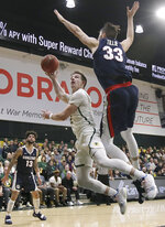 San Francisco guard Frankie Ferrari, center, shoots against Gonzaga forward Killian Tillie (33) during the second half of an NCAA college basketball game in San Francisco, Saturday, Jan. 12, 2019. (AP Photo/Jeff Chiu)