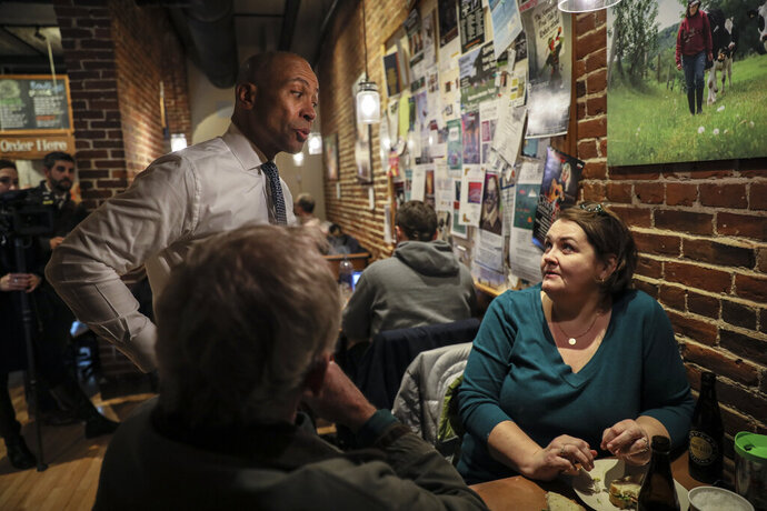 FILE - In this Nov. 25, 2019, file photo, Democratic presidential candidate former Massachusetts Gov. Deval Patrick talks to patrons at The Works Cafe in Concord, N.H. Patrick is running an unorthodox campaign with just over a month until the Democratic presidential primaries start. (AP Photo/ Cheryl Senter, File)