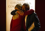Supreme Court Justice Clarence Thomas, right, hugs Notre Dame student Maggie Garnett as he takes the stage Thursday, Sept. 16, 2021, to speak at the University of Notre Dame in South Bend, Ind. The associate justice gave the Tocqueville Lecture for the Center for Citizenship & Constitutional Government at the university. (Robert Franklin/South Bend Tribune via AP)