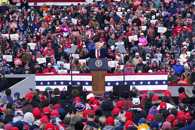 President Donald Trump speaks at a campaign rally, Saturday, Oct. 17, 2020, in Norton Shores, Mich. (AP Photo/Carlos Osorio)