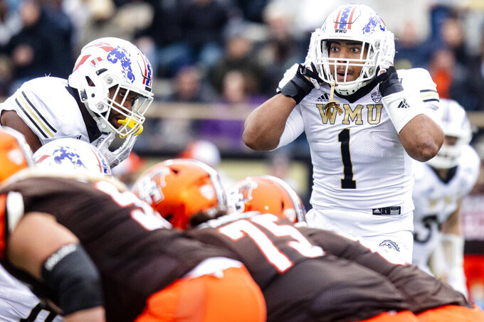 Western Michigan Broncos defensive end Ali Fayad (1) turns to the sidelines for the defensive play call against Bowling Green Falcons during the second quarter of an NCAA college football game in Kalamazoo, Mich., on Saturday, Oct. 26, 2019. (Joel Bissell/Kalamazoo Gazette via AP)