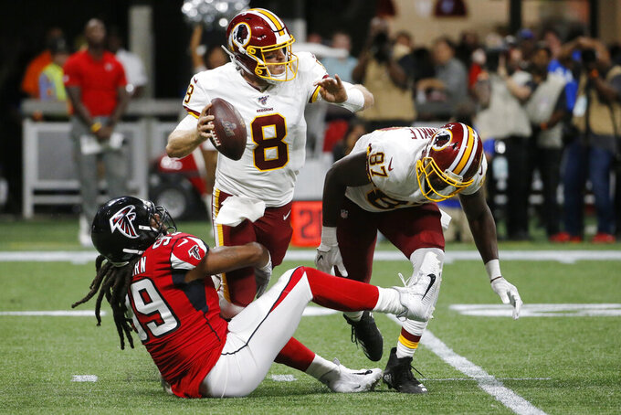 Atlanta Falcons defensive end Adrian Clayborn (99) tackles Washington Redskins quarterback Case Keenum (8) during the first half an NFL preseason football game, Thursday, Aug. 22, 2019, in Atlanta. (AP Photo/Andrea Smith)