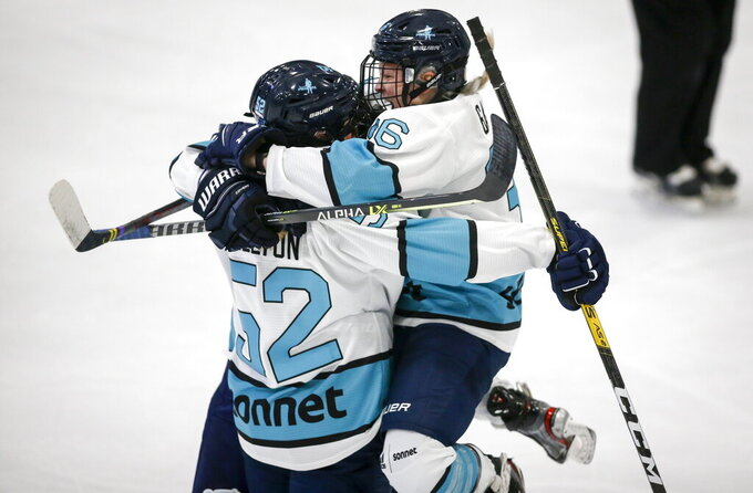 Team Sonnet Ella Shelton, left, celebrates his goal with teammate Loren Gabel during first period PWHPA Dream Tour hockey action against Team Bauer in Calgary, Monday, May 24, 2021.THE CANADIAN PRESS/Jeff McIntosh/The Canadian Press via AP)