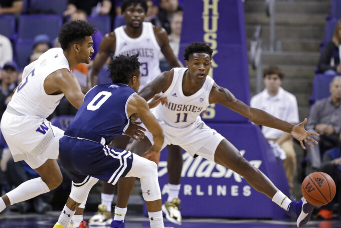 Mount St. Mary's Vado Morse (0) tries to pass as Washington's Nahziah Carter (11) defends during the first half of an NCAA college basketball game Tuesday, Nov. 12, 2019, in Seattle. (AP Photo/Elaine Thompson)
