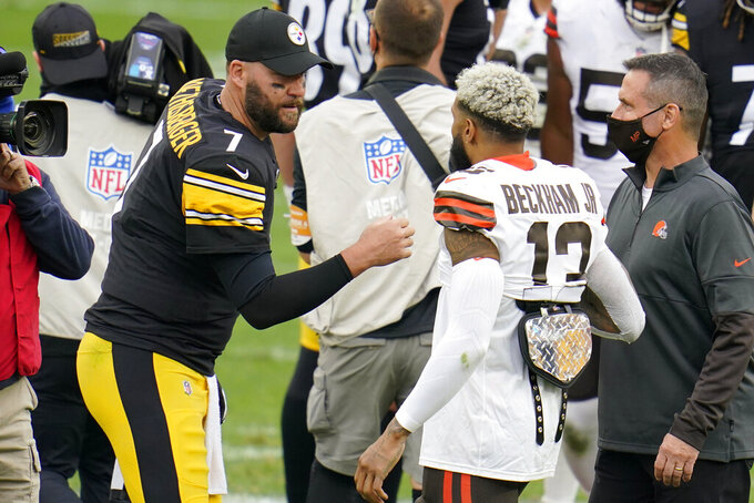 Pittsburgh Steelers quarterback Ben Roethlisberger (7) and Cleveland Browns wide receiver Odell Beckham Jr. (13) meet on the field following an NFL football game in Pittsburgh, Sunday, Oct. 18, 2020. (AP Photo/Gene J. Puskar)