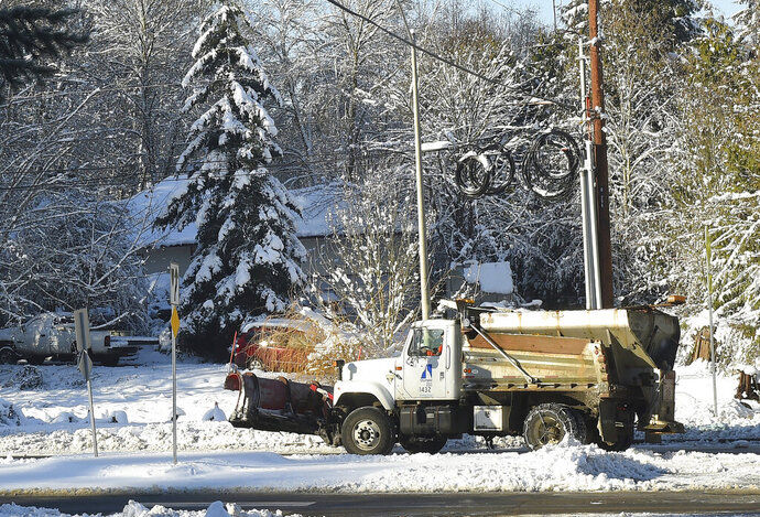 A City of Olympia sanding truck makes it way up a street on Sunday, Feb. 10, 2019, in Olympia, Wash. Pacific Northwest residents who are more accustomed to rain than snow are digging out from a winter storm and bracing for more. (Steve Bloom/The Olympian via AP)