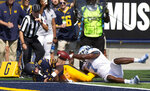 California's Patrick Laird (28) dives into the end zone for a touchdown past North Carolina linebacker Jonathan Smith (7) during the second half of an NCAA college football game, Saturday, Sept. 1, 2018, in Berkeley, Calif. Cal won 24-17. (AP Photo/D. Ross Cameron)