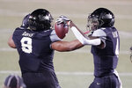 Vanderbilt cornerback Randall Haynie (4) celebrates with defensive lineman Daevion Davis (9) after Haynie intercepted a pass against LSU in the first half of an NCAA college football game Saturday, Oct. 3, 2020, in Nashville, Tenn. (AP Photo/Mark Humphrey)