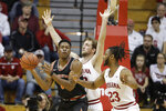 Princeton's Richmond Aririguzoh (34) prepares to pass the ball as Indiana's Joey Brunk (50) and Damezi Anderson (23) defend during the first half of an NCAA college basketball game Wednesday, Nov. 20, 2019, in Bloomington, Ind. (AP Photo/Darron Cummings)