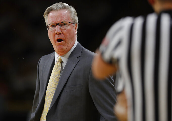 Iowa head coach Fran McCaffery disputes a jump ball with an official during the first half of an NCAA college basketball game against Illinois, Sunday, Jan. 20, 2019, in Iowa City. (AP Photo/Matthew Putney)