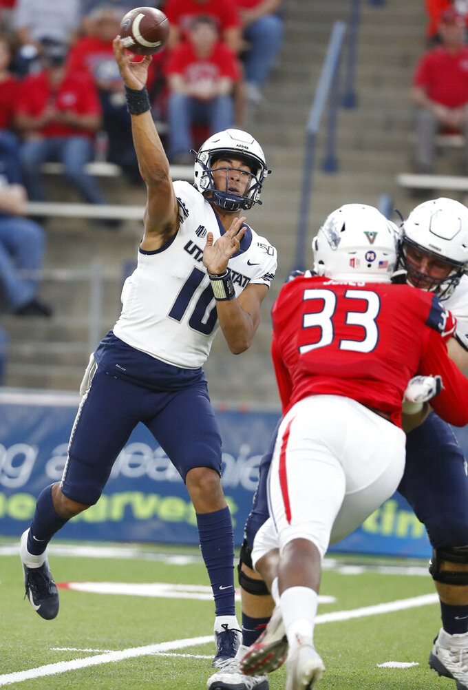 Utah State quaterback Jordan Love throws a pass as Fresno State defensive back Kwami Jones pursues during the first half of an NCAA college football game in Fresno, Calif., Saturday, Nov. 9, 2019. (AP Photo/Gary Kazanjian)