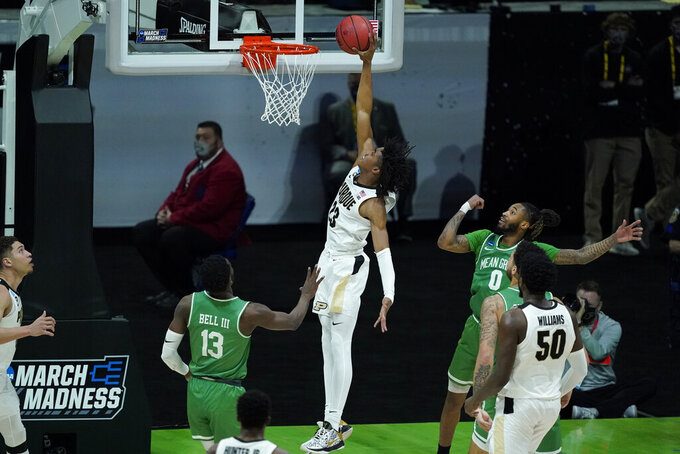 Purdue's Jaden Ivey (23) goes to the basket against North Texas's Thomas Bell (13) and James Reese (0) during the second half of a first-round game in the NCAA men's college basketball tournament at Lucas Oil Stadium, Friday, March 19, 2021, in Indianapolis. (AP Photo/Darron Cummings)