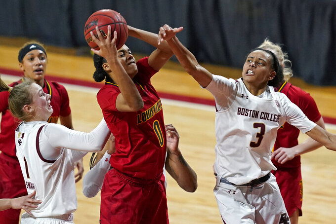 Louisville forward Ramani Parker (0) grabs an offensive rebound against Boston College guards Jaelyn Batts (3) and Cameron Swartz (1) in the second half of an NCAA college basketball game, Thursday, Feb. 4, 2021, in Boston. (AP Photo/Elise Amendola)