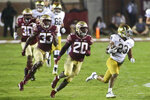 Notre Dame running back Kyren Williams (23) is chased by, from left, defensive lineman Quashon Fuller (30), and linebackers Amari Gainer (33) and Kalen DeLoach (20) on a long run in the third quarter of an NCAA college football game Sunday, Sept. 5, 2021, in Tallahassee, Fla. (AP Photo/Phil Sears)