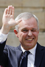 Outgoing Ecology Minister Francois de Rugy waves goodbye after the handover ceremony at the ecology ministry, Wednesday, July 17, 2019 in Paris. Francois de Rugy resigned Tuesday following media reports that he has been living a lavish lifestyle at taxpayer expense, including hosting lobster and Champagne soirees and ordering up exorbitant renovations of his ministerial apartment. (AP Photo/Kamil Zihnioglu)