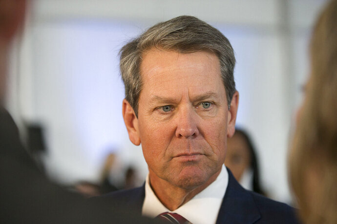 """FILE - In a Friday, September 20, 2019 file photo, Gov. Brian Kemp answers questions from the media in Dalton, Ga. Georgia's Republican Gov. Brian Kemp is pushing back against speculation over whom he'll appoint to replace retiring Republican Sen. Johnny Isakson. Kemp took to Twitter on Wednesday, Nov. 27, 2019 to slam what he called the """"attacks and games"""" and said more information about his choice would be available after Thanksgiving.(Alyssa Pointer/Atlanta Journal-Constitution via AP, File)"""