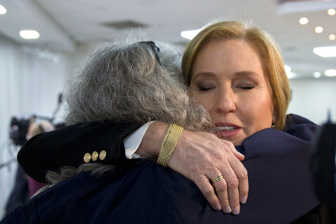 Former Israeli Foreign Minister Tzipi Livni hugs a supporter prior to a press conference in Tel Aviv, Israel, Monday, Feb. 18, 2019. Livni, on Monday, announced her retirement from politics. (AP Photo/Sebastian Scheiner)